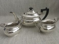 Ornate vintage silver plated set of three  boat shape tea pot ,  sugar bowl and cream jug . Makers initials, CSC LTD SHEFFIELD OF ENGLAND. ca- 1930/1940