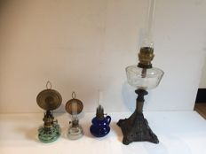 Four oil lamps of which one a metal base - circa 1920