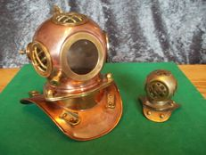 Very nice yellow with red copper diving helmet plus smaller brass diving helmet