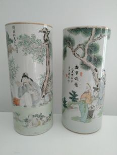 2 cylindrical vases, famille rose, 'qian jiang cai', porcelain decorated with children and elderly - China - circa 1920