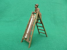 Nickel plated brass thermometer with a chimney sweep figurine on a ladder - ca  1910