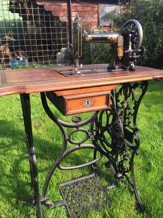 Beautiful old-fashioned sewing table from the early 20th century.