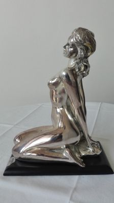Silver laminated female nude on wooden base