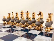 Gold and marble chess set