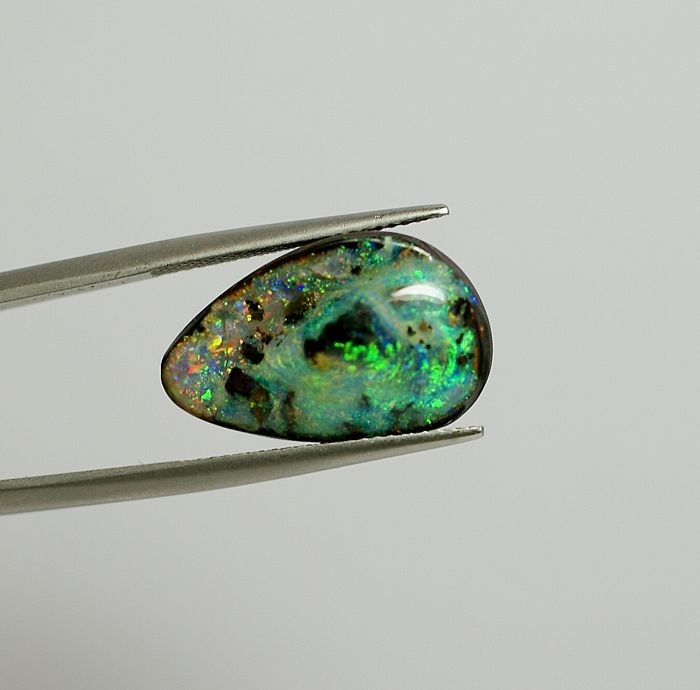 Boulder Opal - orange  with play of colour - 14.66ct