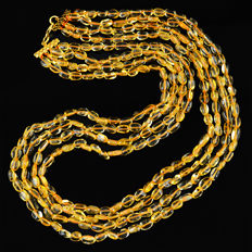 Citrine necklace with 18 kt (750/1000) gold, length 60cm.