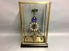 Skeleton clock with moon phase and date, beneath a glass case, on a wooden console, with a fusee escapement movement - mid 20th century - one-year warranty
