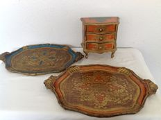Two large Venetian wooden serving trays and a miniature Venetian chest of drawers