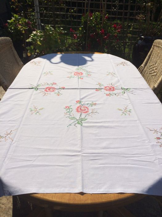 White cotton tablecloth hand embroidered with roses. 180 x 120 cm.