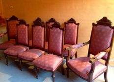 Hand carved set of chairs made of walnut wood composed of six chairs, two couches and a three-sit-sofa c. 1915