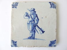 Antique tile with a Soldier and his musket.