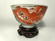 Porcelain bowl with foo dog decoration and calligraphy - China - circa 1930