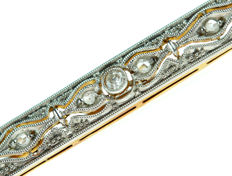 14 karat yellow gold Art Deco brooch set with diamonds with a mille griffe decoration