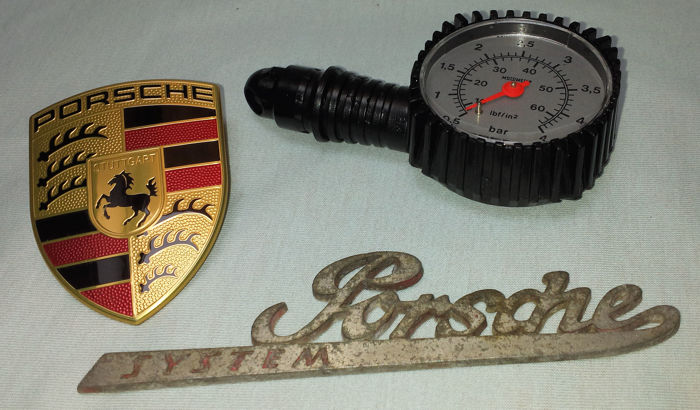 Three Porsche items - Air pressure gauge and emblem as good as new condition