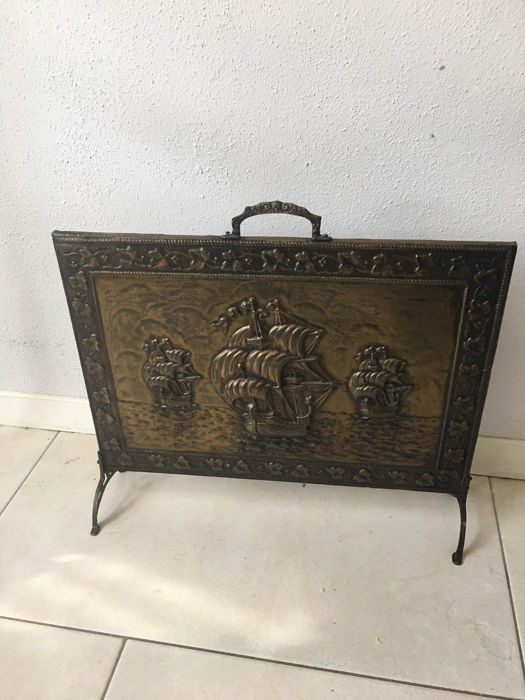 beautiful brass fireplace screen with image of sailing ships