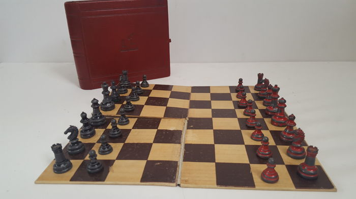 Antique metal chess set with secret hiding in form of book
