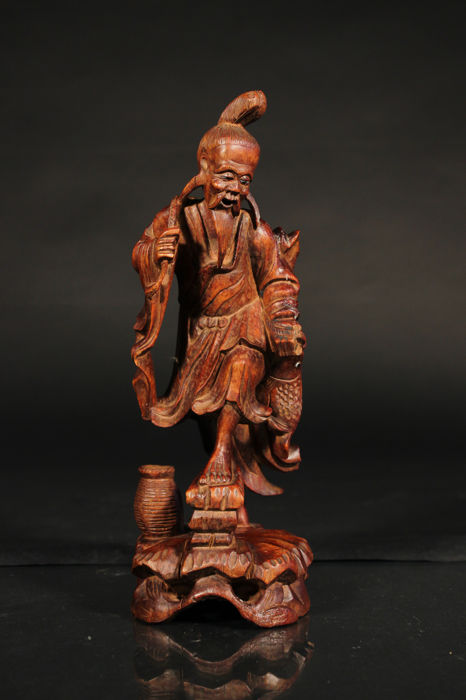 Hardwood carving depicting a man with a fish - China - Around 1900
