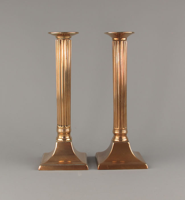 A pair of neo-classical style brass candlesticks - circa 1780