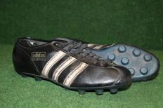 Old decorative Adidas football boots from 1964