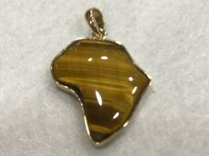 Africa pendant in 18 kt gold and tiger's eye