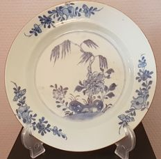 A deep blue and white decorative plate – China – 18th century
