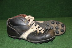Old decorative football boots from the 1960s
