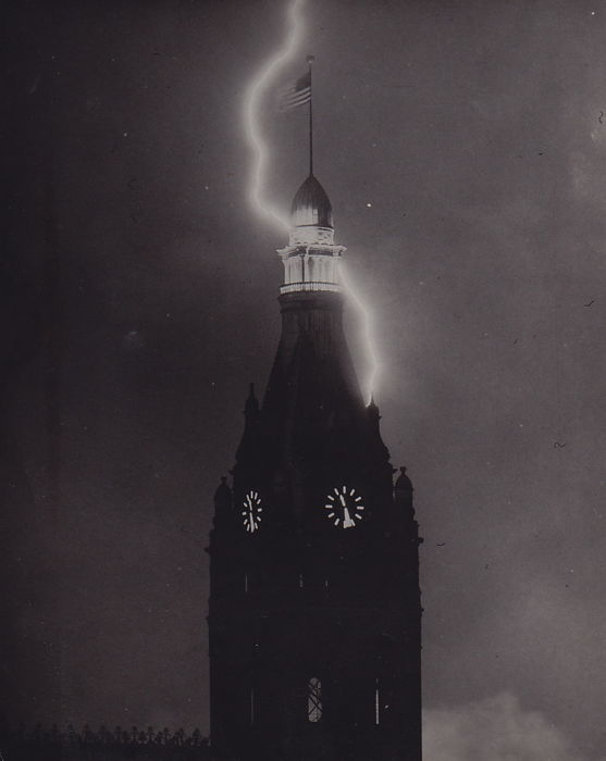 Unknown and James L. Stanfield/ The Milwaukee Journal -  Milwaukee's City Hall with lightning and eclipse - 1950 and 1961
