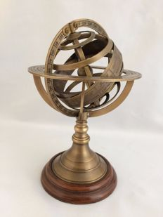 Brass armillary or sky globe on wooden base