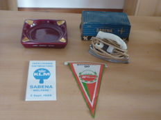 Lot including an ashtray + iron + tiling with logo and an Air Portugal pennant