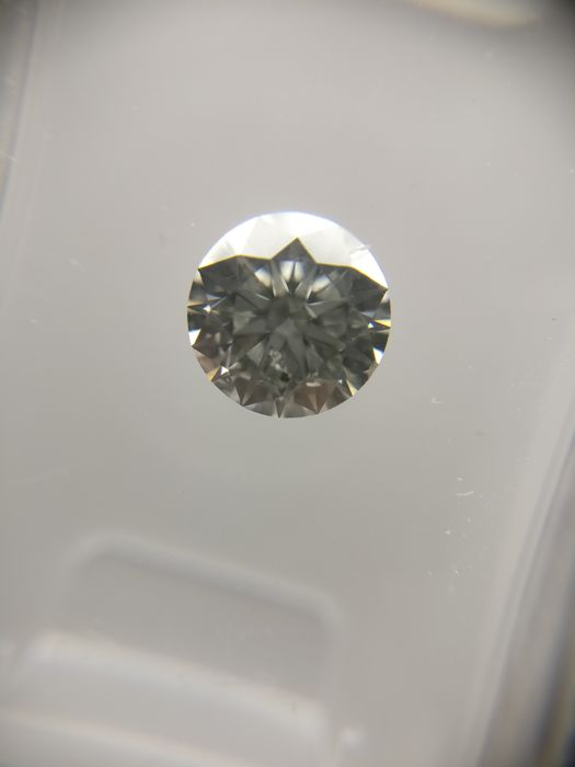 0.64 ct Round cut diamond E SI1