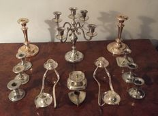 13 beautiful silver-plated and copper candlesticks.