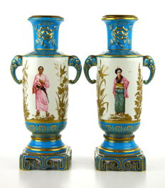 A pair of polychrome and gilt porcelain vases