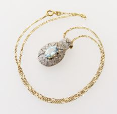 14kt white gold pendant with natural aquamarine & diamonds 0.22ct on 14kt yellow gold necklace, length of necklace approx. 42cm