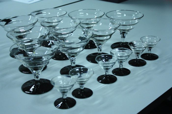 9 Art Deco champagne coupes with 6 matching liqueur glasses