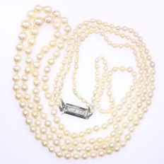 Estate two row pearl necklace with white gold closure set with diamonds
