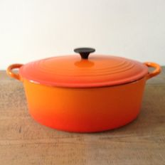 'LE CREUSET' - oval cooking pot with lid in beautiful orange enamel cast iron.