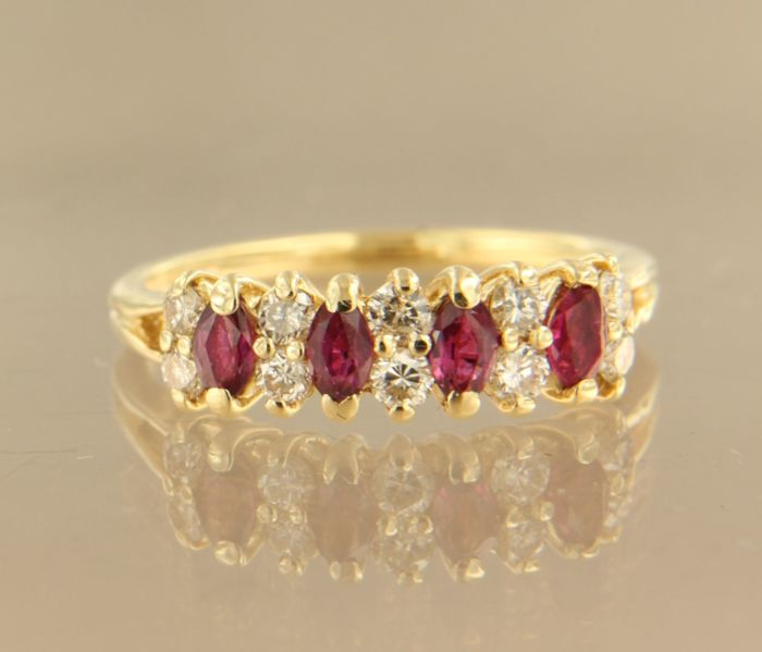 14 kt yellow gold ring set with 4 marquise cut rubies, 1.00 ct, and 10 brilliant cut diamonds, 0.50 ct ****NO RESERVE PRICE****