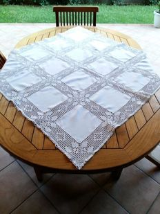 Handmade tablecloth with lace inlays