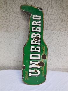 Old heavy enamel sign for Underberg in bottle shape with a gold edge and signed