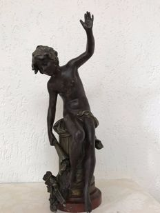 Attributed to Auguste Morceau (1834 - 1917) - 'Amour désamé' - zamak sculpture of a young man on a column - France - late 19th century.