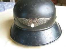 German Luftschutz helmet with lining, chin strap and badge