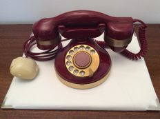 Beautiful vintage phone from the 1980s, red and gold