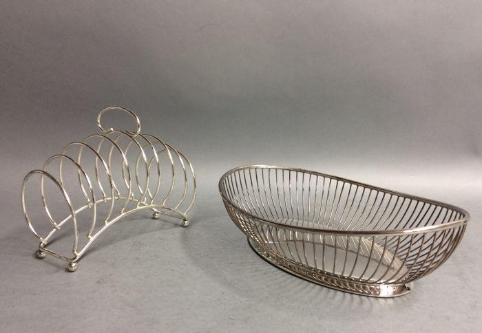 Breakfast duo consisting of a silver plated bread basket and a toast rack, mid 20th century