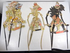 Three big wayang kulit dolls - Java - Indonesia - mid 20th century