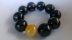 Round beads Baltic Amber modified cognac colour  with Black accent bracelet, diameter circa 54 mm, 60 gram