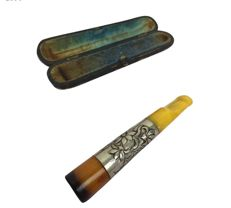 Art Nouveau cigarette holder made of amber (egg yolk) with silver tips in the case - ca 1980