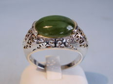 A silver men's ring with big nephrite stone