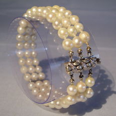 A genuine 3-row Akoya pearl bracelet with 14 karat gold clasp adorned with 0.03 ct in diamonds