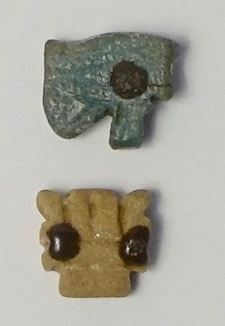 Two amulets with an Udjat eye and a feline head, Egypt - 1.2 and 1.3 cm