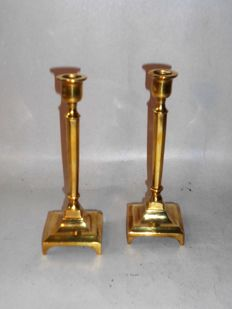 A pair of 17th century gilt bronze table candlesticks